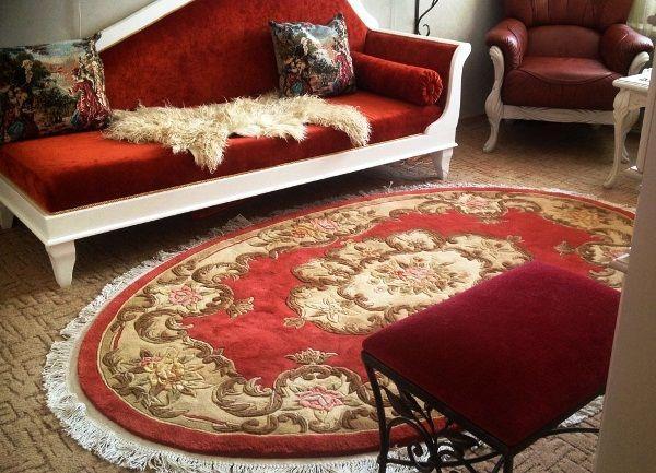 ковры в интерьере гостиной фото 14